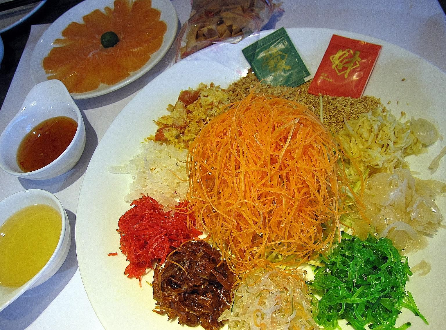 The raw fish salad was brought to Singapore by Cantonese immigrants in the 1940s, and was later popularised as a Chinese New Year dish.