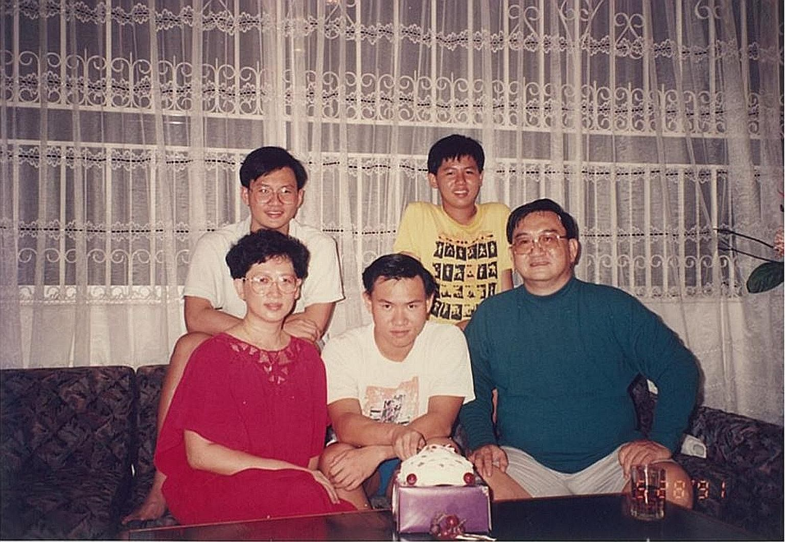 Mr Fu Shou Jeen (back row left) and Mr Fu Siang Jeen (first row centre) with their parents, Mr Fu Weng Leng and Madam Leow Fie Yin, and brother Tong Jeen. Brothers Fu Siang Jeen (above right) and Fu Shou Jeen are the only third-generation members fro