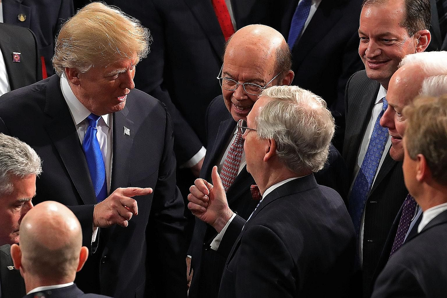 US President Donald Trump with top Republicans following his State of the Union address last month. Voices from within the party have been warning him against following through on his tough talk on trade with China.