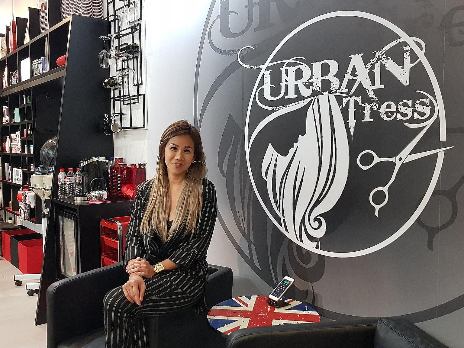 Tresses Studio's Mr Kenny Chew signed up for a hair-salon accreditation scheme. Mrs Jeanie McLean, who runs her own salon, says once she proves her skills to her clients, they trust her. Mi the Salon's founder Gary Chew personally cuts and dyes his c