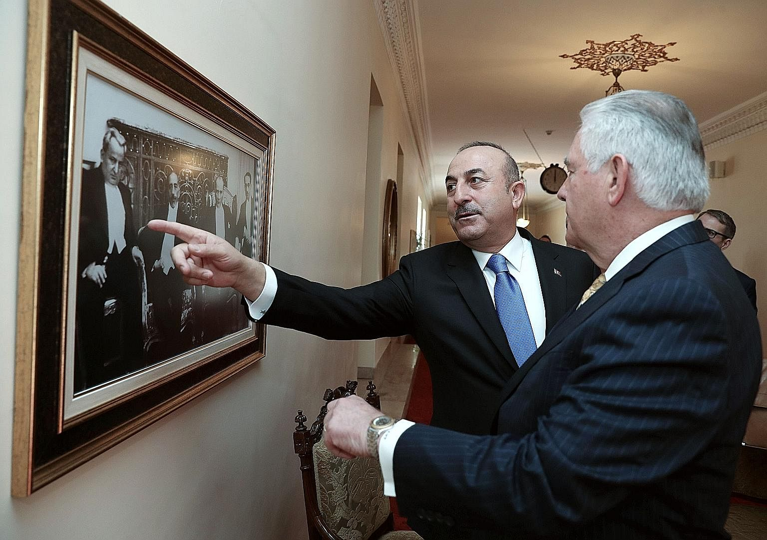 United States Secretary of State Rex Tillerson being shown a picture of the founder of modern Turkey, Mustafa Kemal Ataturk, by Turkish Foreign Minister Mevlut Cavusoglu last Friday. Mr Tillerson's main focus during his stopover in Ankara was the str