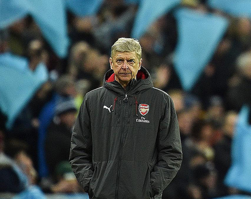 Arsene Wenger cuts a despondent figure during the League Cup final.