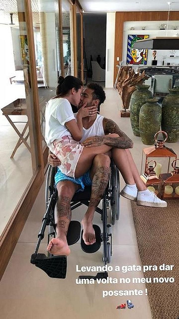 Wheelchair-bound Neymar sharing a tender moment with his actress girlfriend Bruna Marquezine. The Brazilian faces an uncertain spell on the sidelines after undergoing surgery to mend his metatarsal.