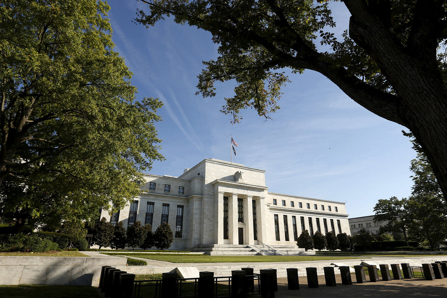 The Federal Reserve headquarters in Washington. UBS now expects the Fed to hike interest rates four times in 2018 (from three) and three times in 2019 (from two), taking the Fed fund target rate to just over 3 per cent by end-2019.