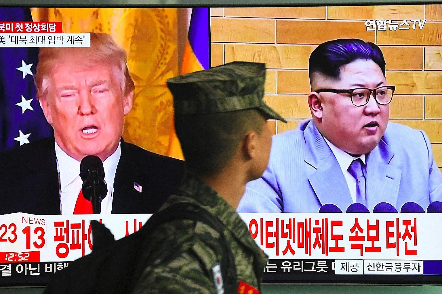 A television screen showing pictures of Mr Donald Trump and Mr Kim Jong Un at a Seoul railway station on Friday.