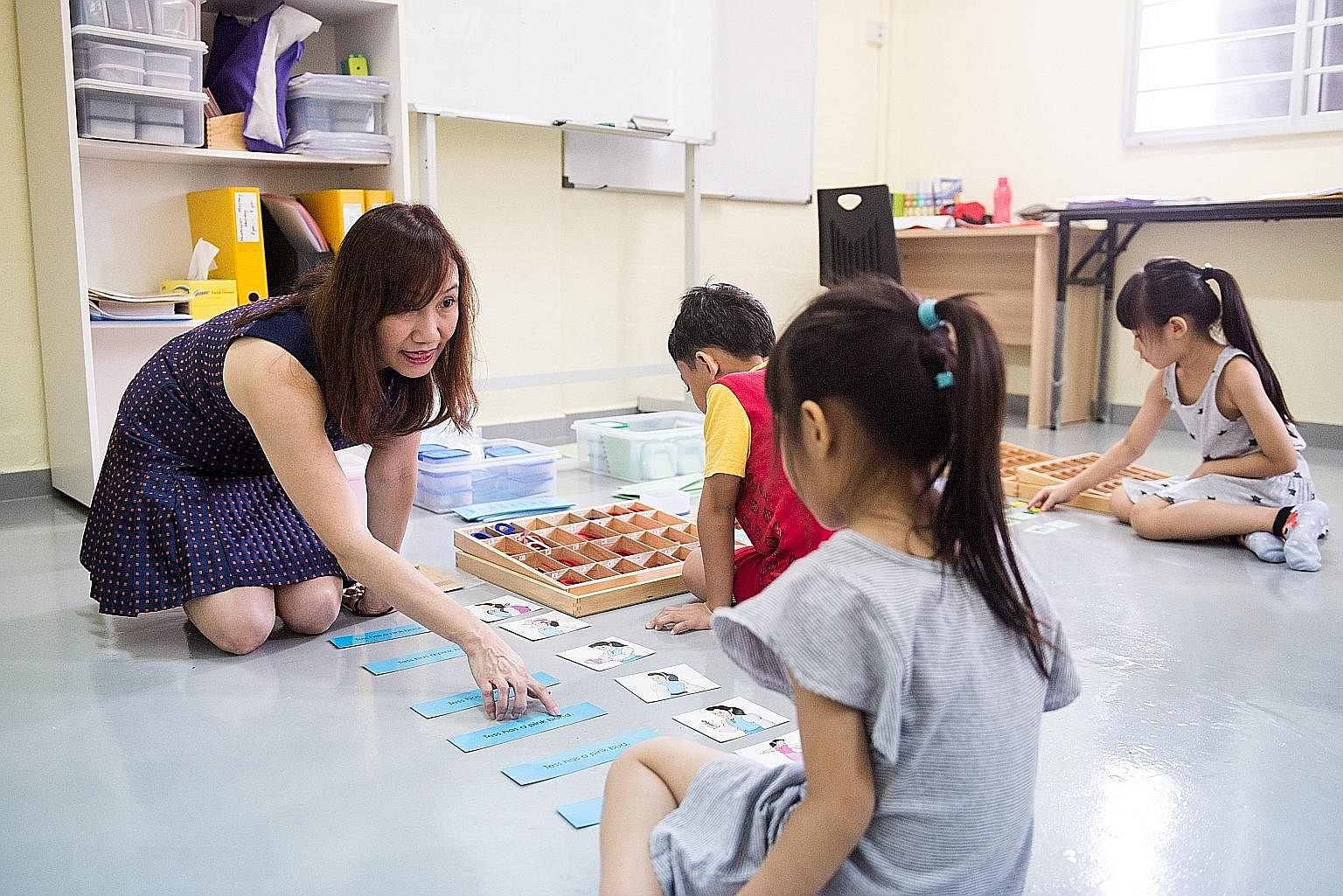 Mrs Fiona Tan with children at Intelligent Minds Learning Centre, which she and her husband set up in 2016. The tuition centre broke even after the first year and has remained profitable.