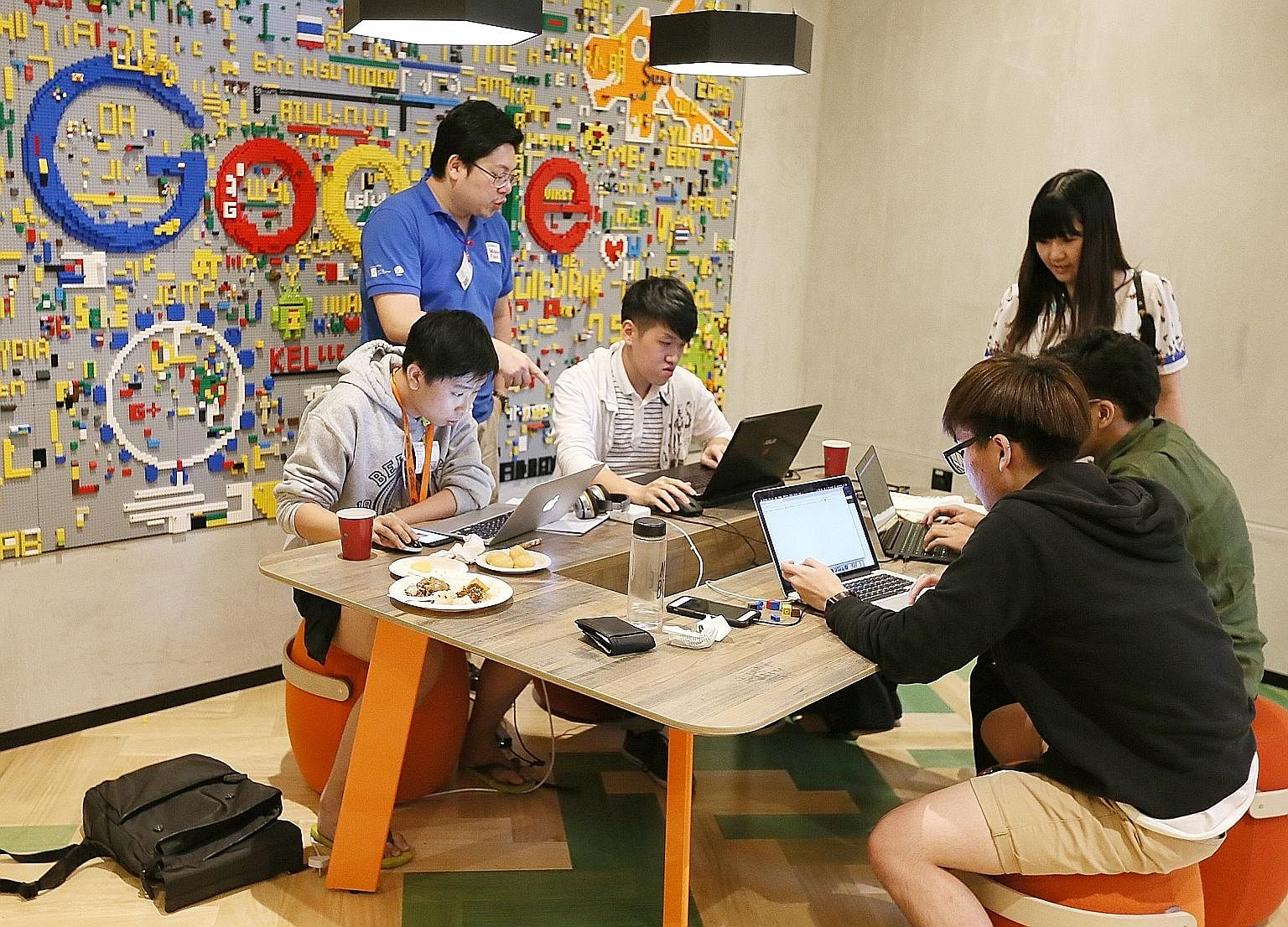 Tertiary students working to come up with ideas to improve the fact-checking process at a fake news hackathon last year organised by the National University of Singapore, Singapore University of Technology and Design, Google and the Media Literacy Co