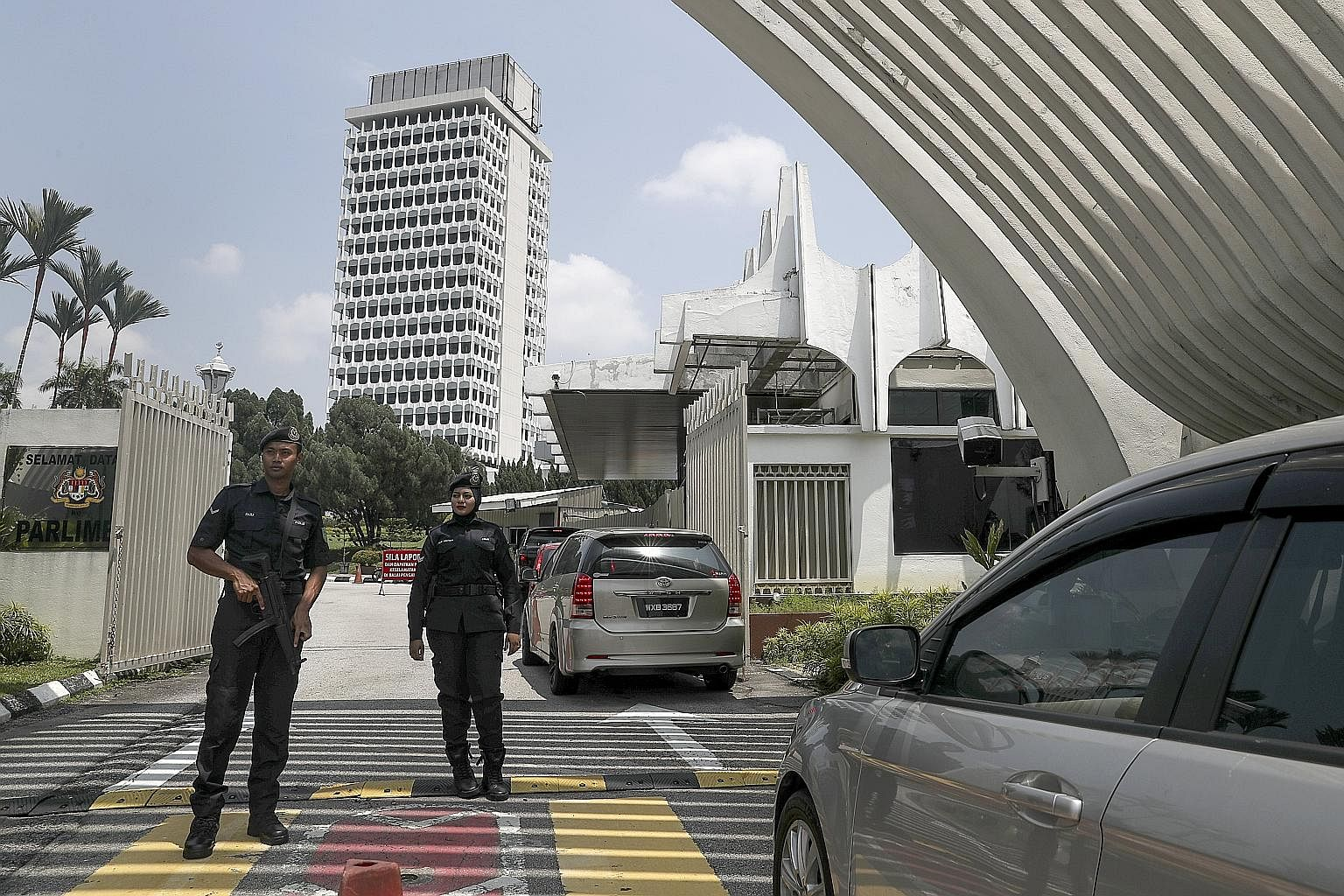 Royal Malaysian Police officers guarding the entrance to Parliament in Kuala Lumpur. Less than a year ago, the Chinese were angry with ultra Malay group Perkasa but now, many of them have donned the Pribumi uniforms and the party is cheered on by man