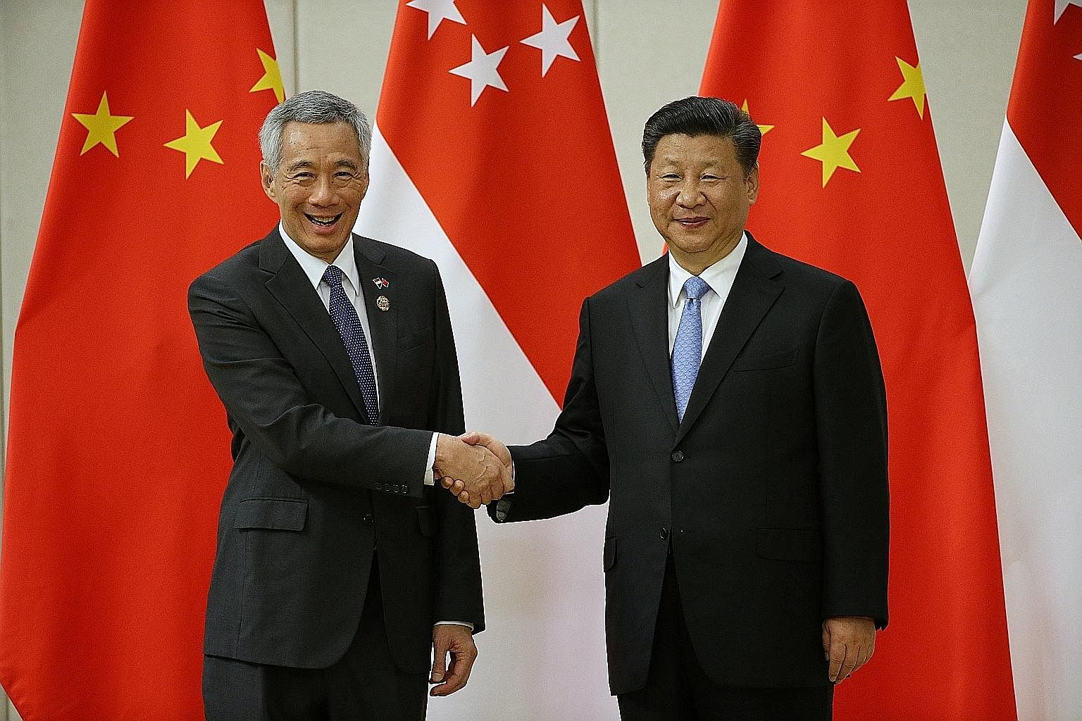 Prime Minister Lee Hsien Loong with Chinese President Xi Jinping at the Boao Forum on Tuesday. Mr Lee says in his speech that China's role in the international economy will grow larger. This has shifted the overall strategic balance. It has also rais