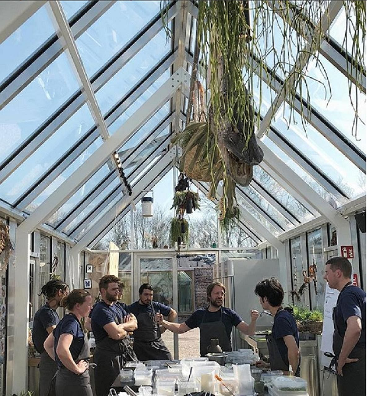 """At the new Noma restaurant, work is carried out in a cluster of """"huts"""" connected by glass-roofed corridors."""