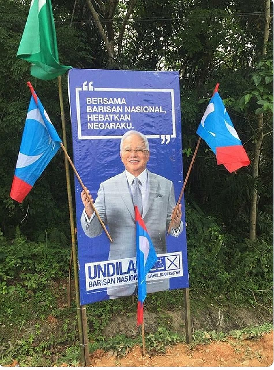 The BN poster with PKR flags stuck on it to make it look like Prime Minister Najib Razak was cheering on the opposition.