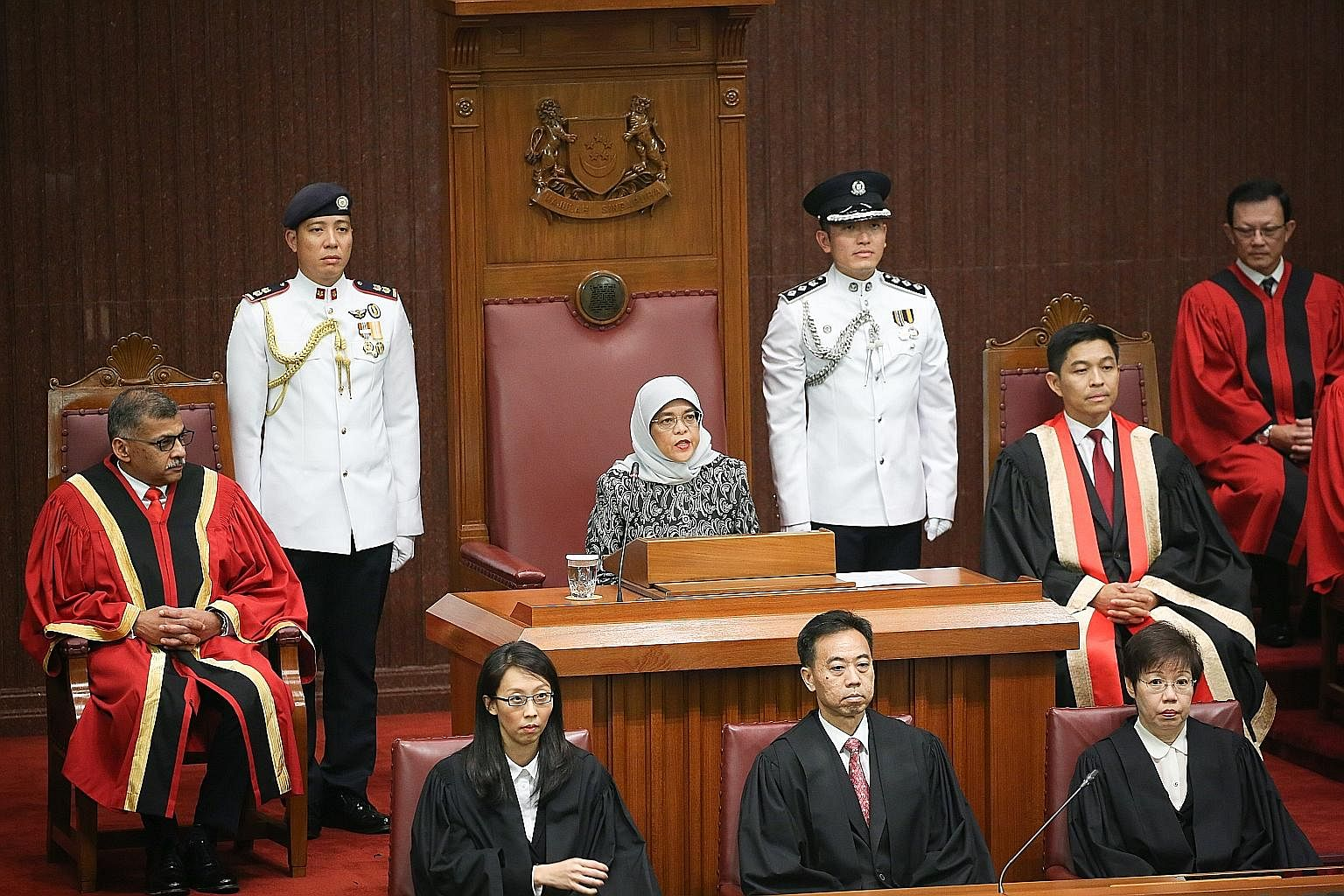 President Halimah Yacob, flanked by Speaker of Parliament Tan Chuan-Jin and Chief Justice Sundaresh Menon, representing the different branches of government, addressed a packed chamber at Parliament House yesterday.