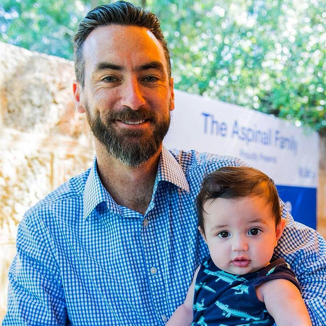Opposition Labor party's Mr Tim Hammond with his seven-month-old son Tully. He said video calls did not make up for the regular absence from his three young children.