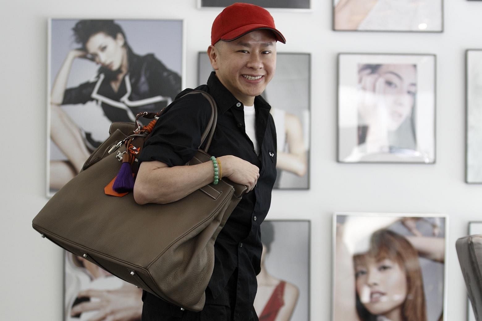 f5dbfd5e3b49 Celebrity hairstylist David Gan carrying a taupe Hermes Birkin bag. PHOTO   ST FILE