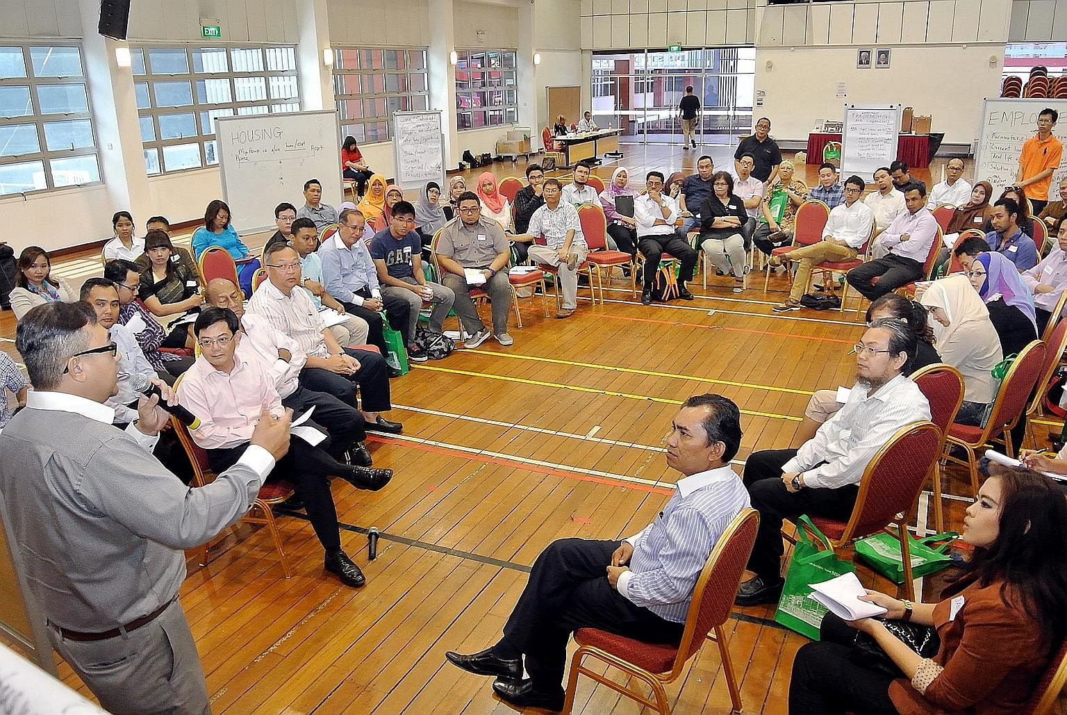 A participant speaking at an Our Singapore Conversation session in July 2013. Among those present were Mr Heng (left, seated). The minister said yesterday that he met many people during these sessions who cared deeply about issues and took proactive