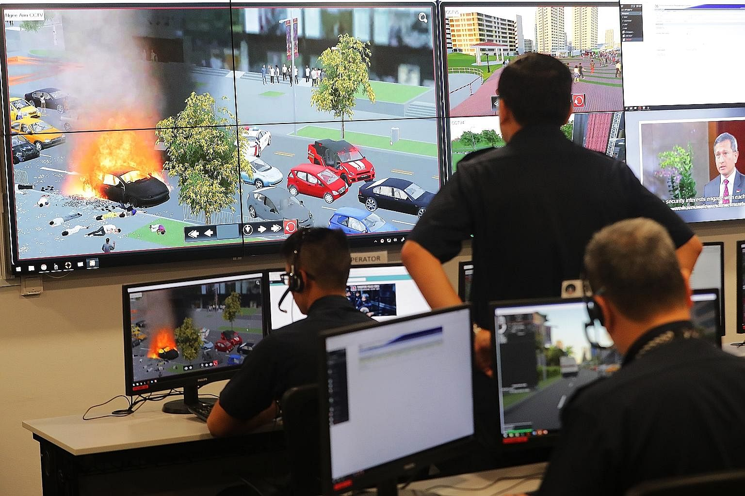 Simulation of a car explosion being monitored in the command post at the Home Team Simulation Centre. The simulation system allows up to 20 commanders from different departments to be trained in joint operations. A simulation exercise can take up to