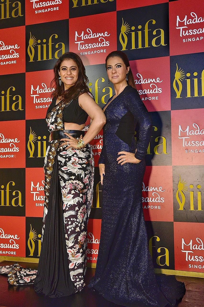 Bollywood star Kajol with her wax statue at Madame Tussauds Singapore.