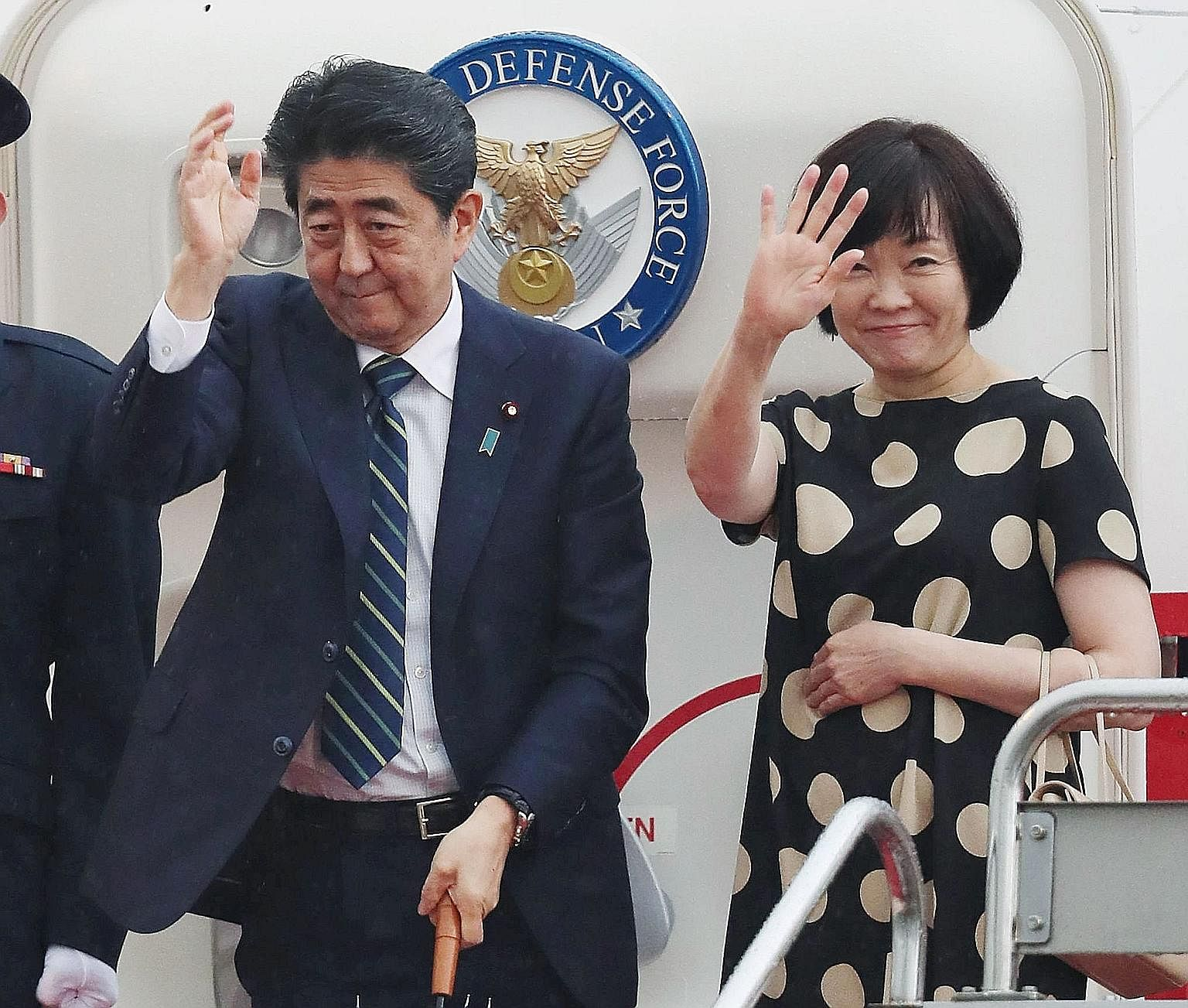 Mr Shinzo Abe and his wife, Akie, at Tokyo's Haneda Airport before leaving for the United States.