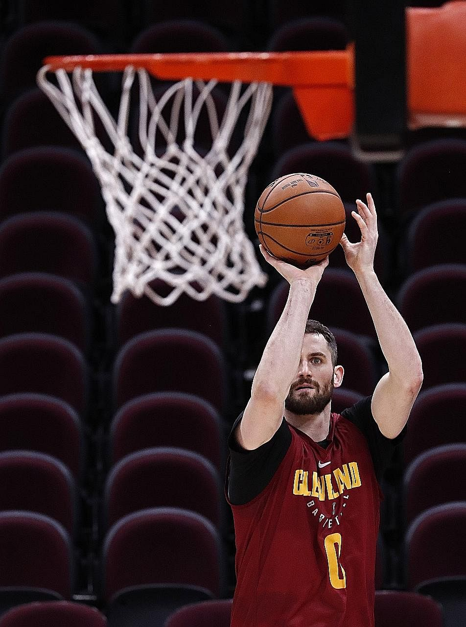 Cleveland's Kevin Love taking a shot during practice on Tuesday ahead of Game 3 of the NBA Finals at Quicken Loans Arena in Cleveland. With the visitors 2-0 up, this is virtually a must-win game for the Cavaliers, who have lost two of the last three