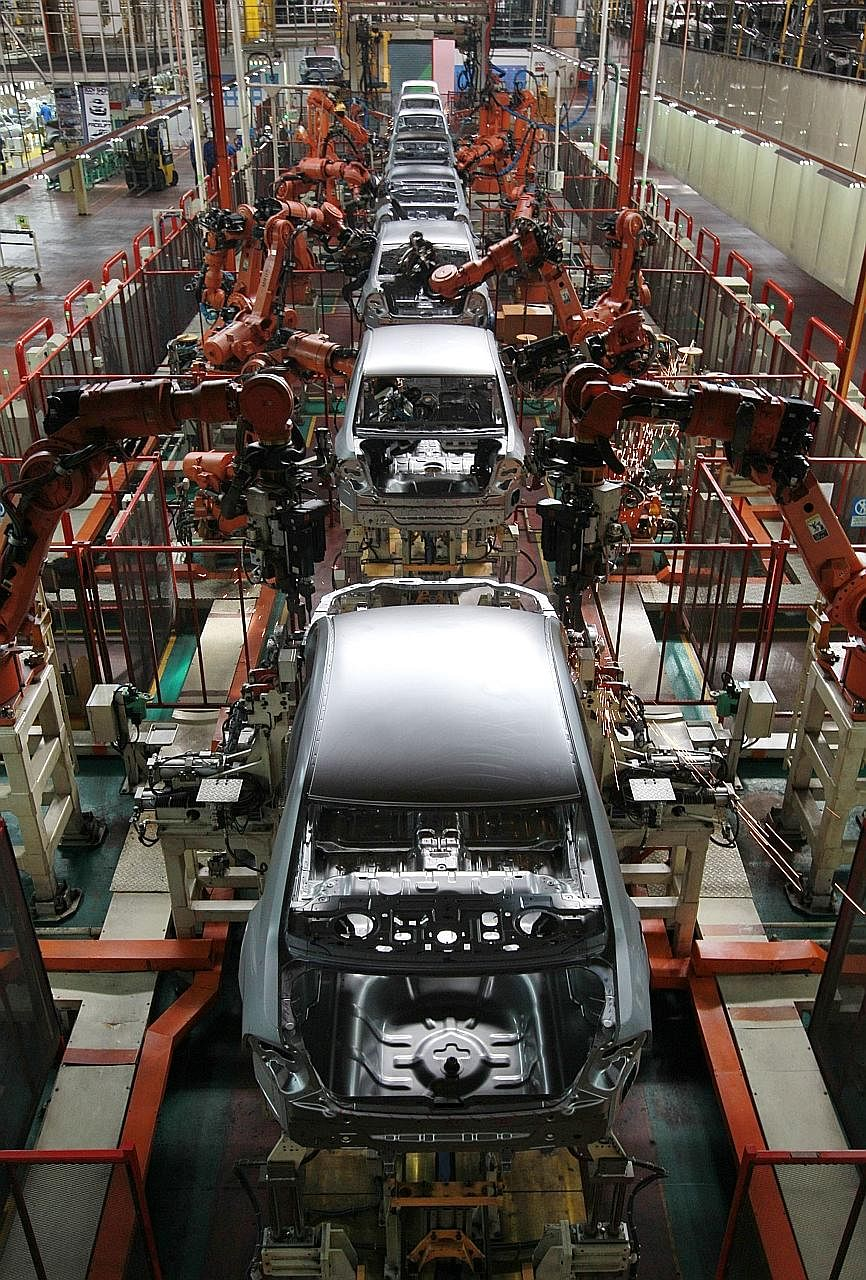 Proton vehicles being assembled at the company's factory in Selangor. Over the years, Proton has incurred huge debts and a 49.9 per cent stake in the firm was sold to China's Geely last year.