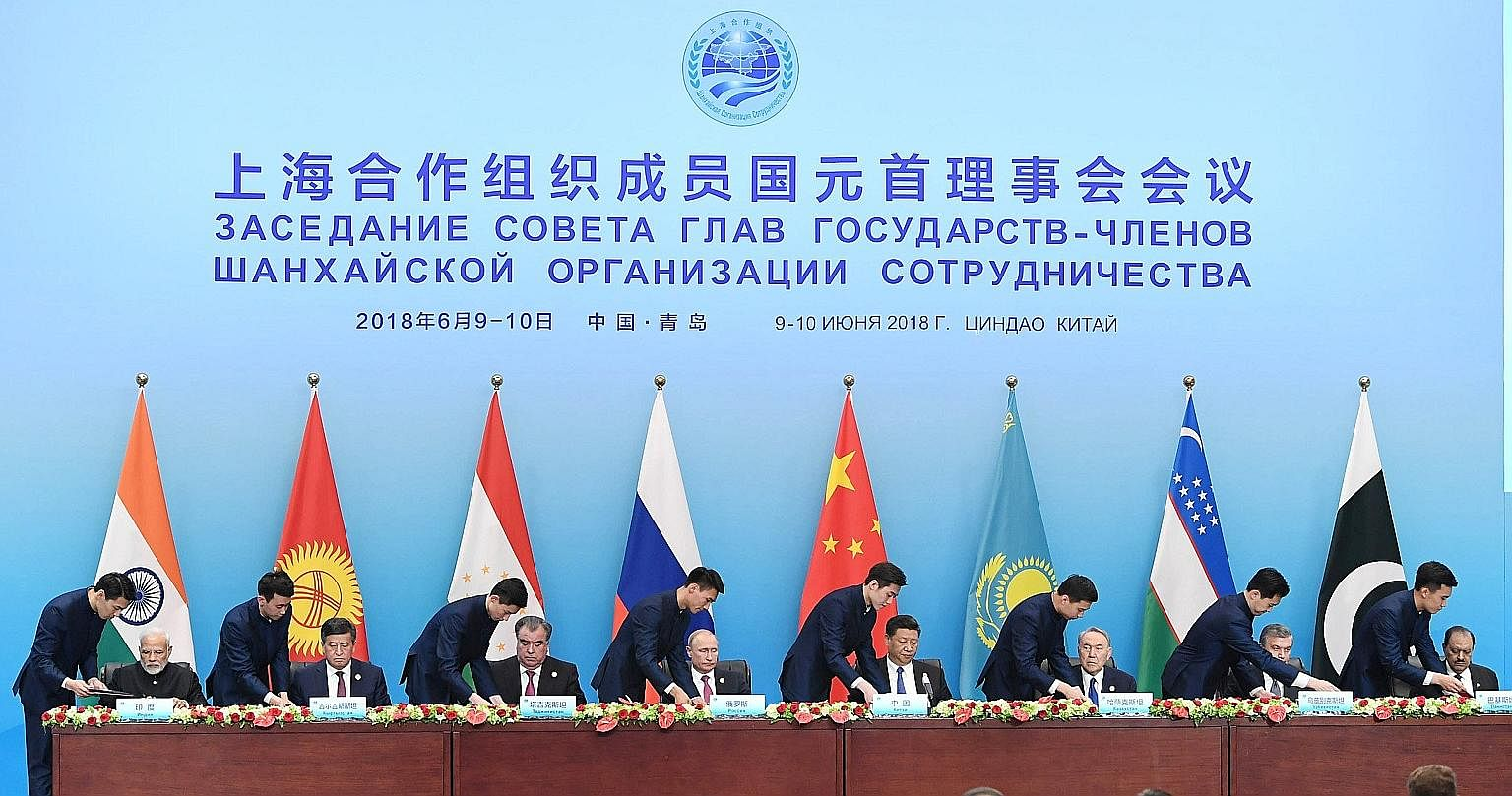 "Leaders of the eight countries under the Shanghai Cooperation Organisation at a signing ceremony over the weekend. The China Daily newspaper said the summit was a good example of multilateral cooperation, offering a ""new vision"" for a more just and e"