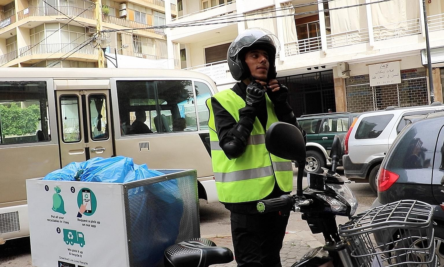 Syrian refugee Ibrahim Habach is one of 400 Live Love Recycle's e-bike couriers who collect recyclable waste in Beirut.