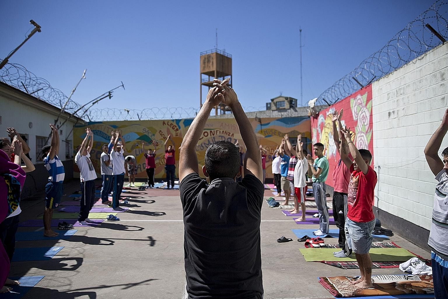 Moksha volunteers teaching yoga to inmates of the San Martin state prison. Currently, 20 instructors volunteer for the Moksha project, which has been organising yoga lessons since 2015 in two units of the prison in Buenos Aires.