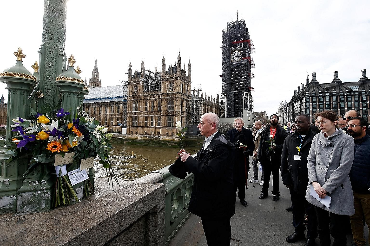 People marking the anniversary of last year's terror attack on London's Westminster Bridge.