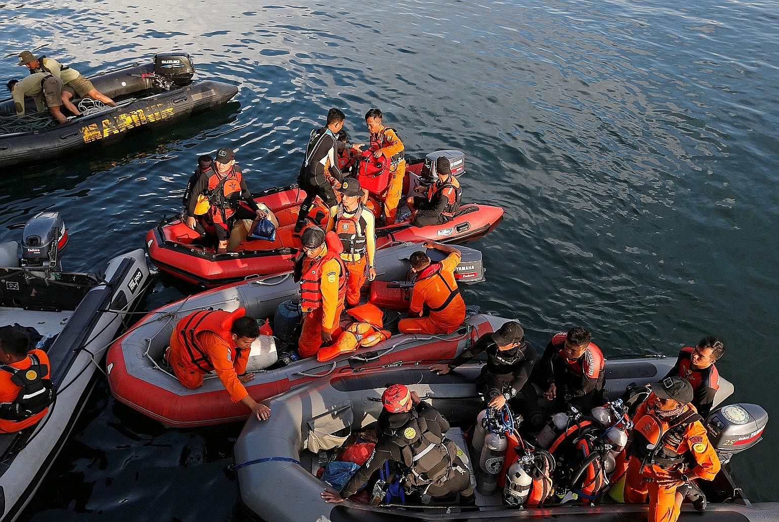 Rescuers looking for missing people after Monday's ferry accident on Lake Toba in Indonesia.