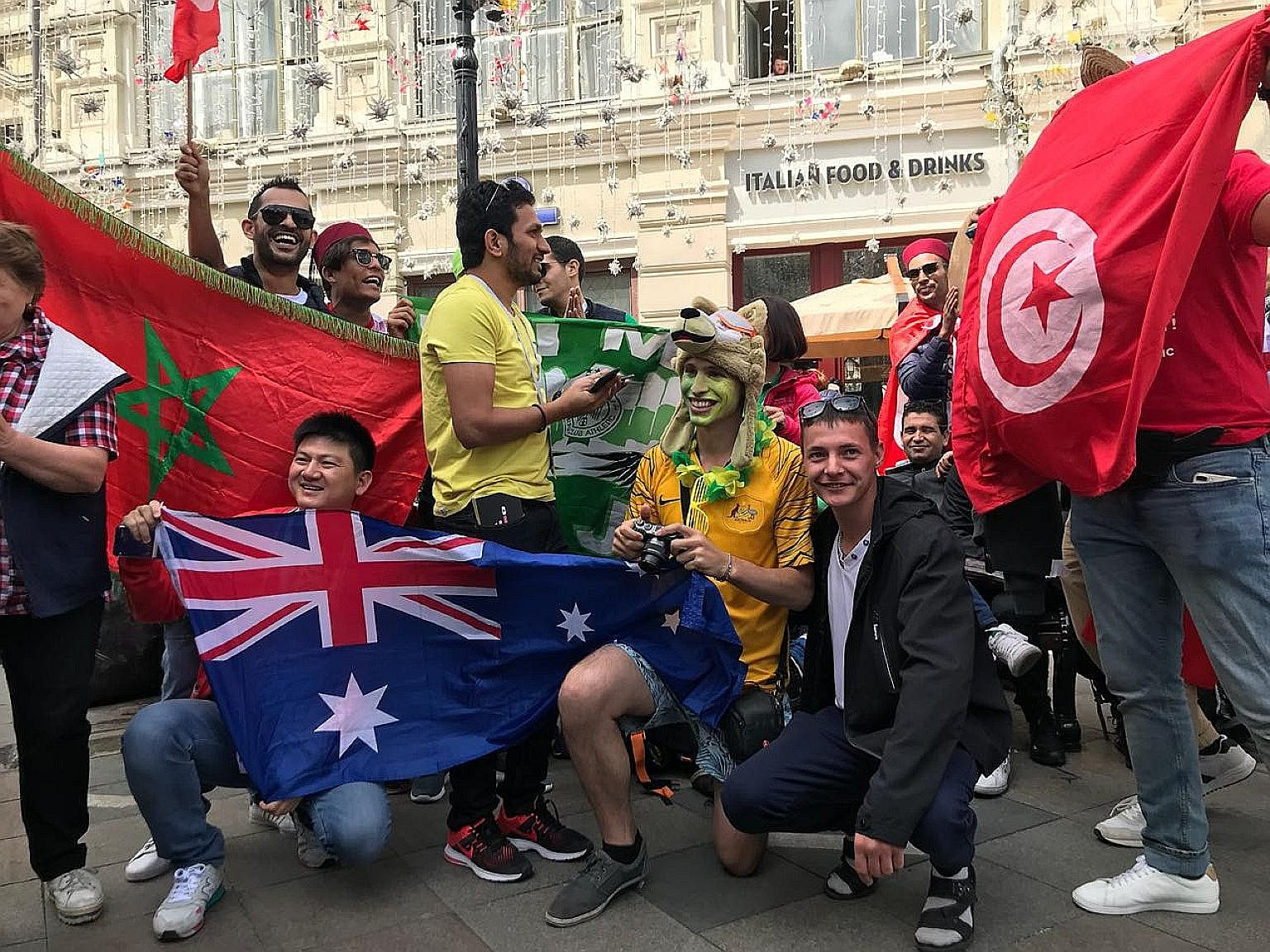 This impromptu gathering is like a mini-United Nations of the football faithful; Standing beside his trusty bicycle festooned with several national flags, Argentinian Maty Amaya tells the story of his six-year journey on two whee
