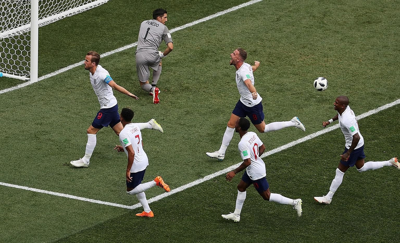 England captain Harry Kane (at left) celebrating his second goal - a penalty in first-half stoppage time - in their 6-1 Group G win over Panama yesterday. He also struck in the 22nd (penalty) and 62nd minutes to become only the third England player t