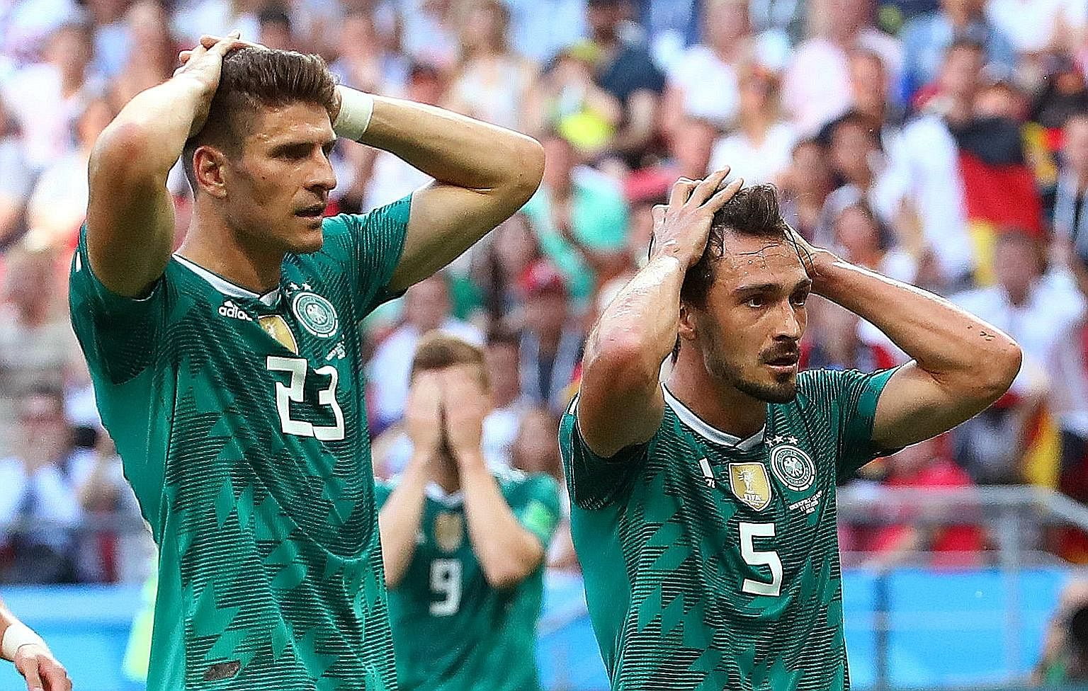 Defending champions Germany crashed out of the World Cup after a shock 0-2 Group F loss to South Korea yesterday. This is the first time the Germans have been eliminated in the first round since 1938. Sweden defeated Mexico 3-0 in the other match to