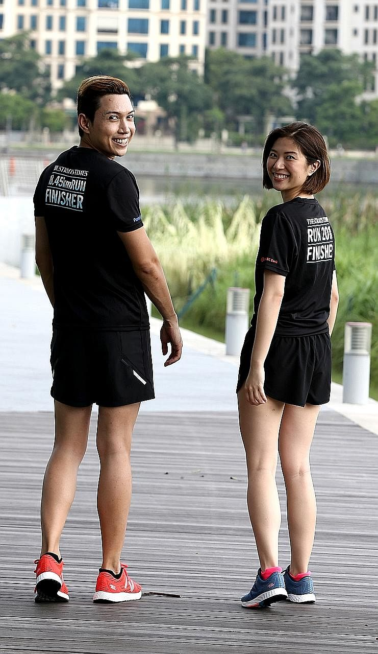 Straits Times multimedia journalists Hairianto Diman and Alyssa Woo donning the men's and women's race vests (left), and the finishers' T-shirts.
