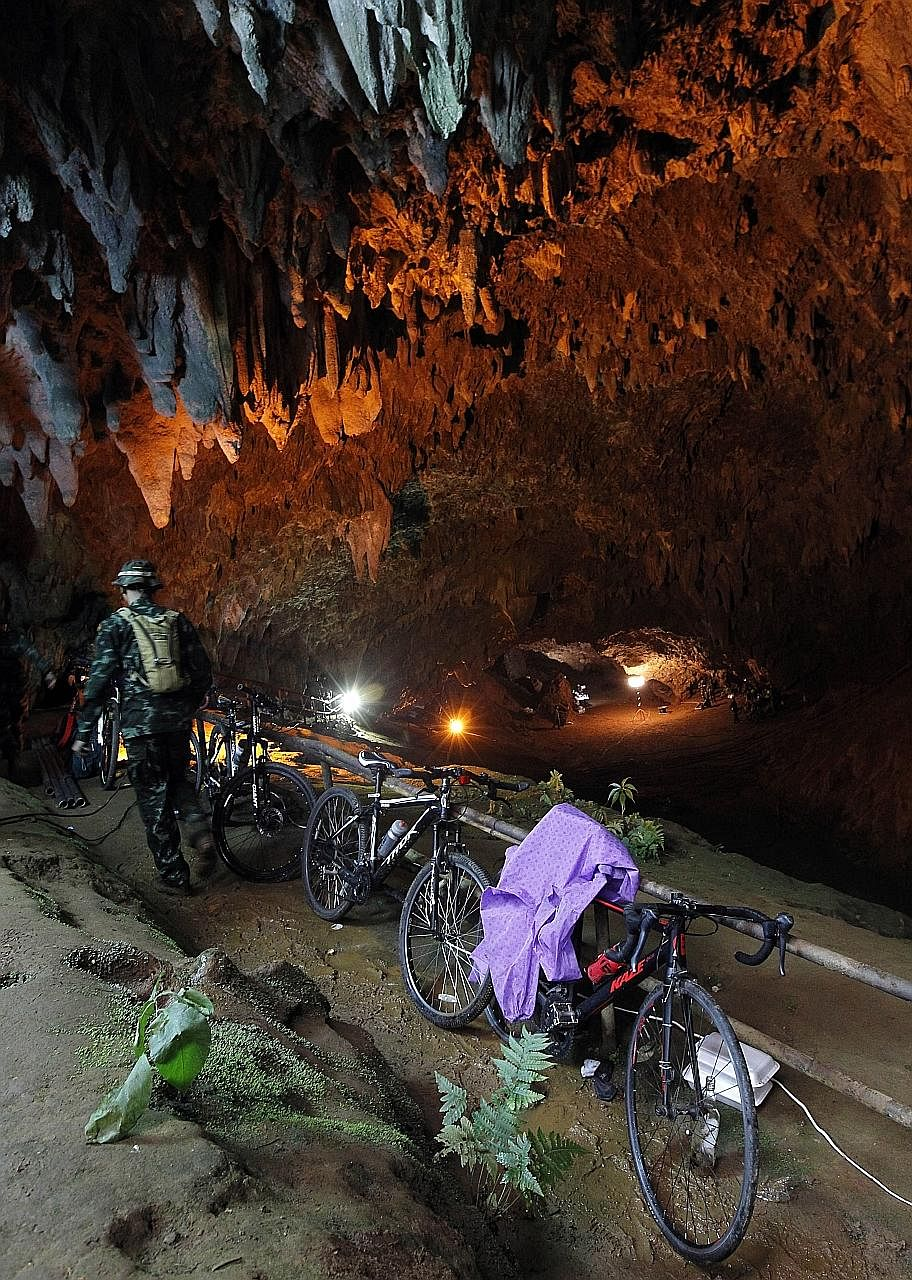 Rescue workers pumping water out of the cave on Thursday. However, the pumps could not keep up as rainfall continued. Bicycles belonging to the missing football players at the entrance of Tham Luang cave in Chiang Rai province, Thailand, on Tuesday.