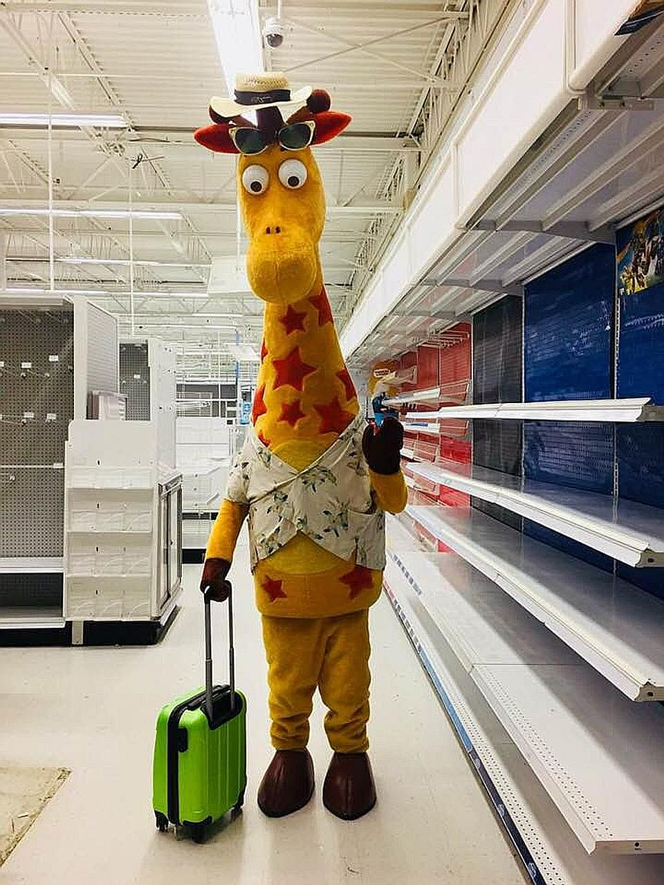This photo of mascot Geoffrey the Giraffe leaving an empty Toys 'R' Us store has gone viral, as the iconic toy retailer closed the last of its 735 outlets across the United States.