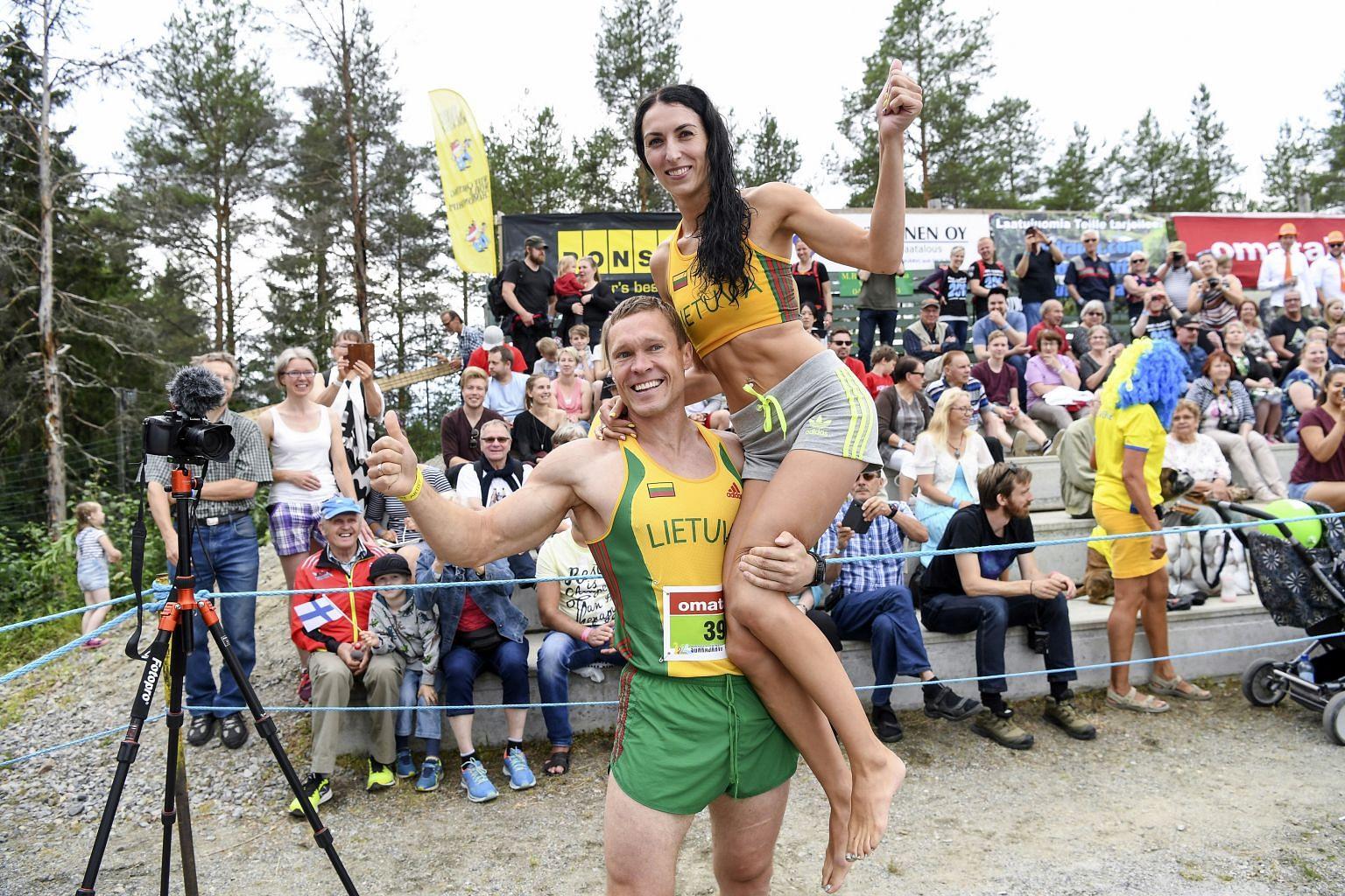 Αποτέλεσμα εικόνας για Vytautas Kirkliauskas of Lithuania carries his wife Neringa Kirkliauskiene