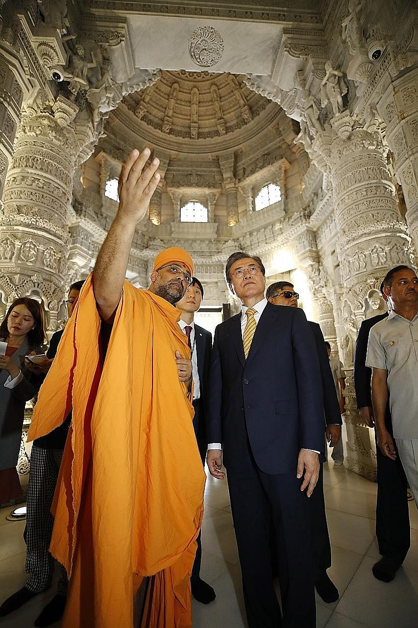 South Korean President Moon Jae-in visiting the Swaminarayan Akshardham Hindu temple in New Delhi on Sunday. He is set to hold a bilateral summit with Indian Prime Minister Narendra Modi today.