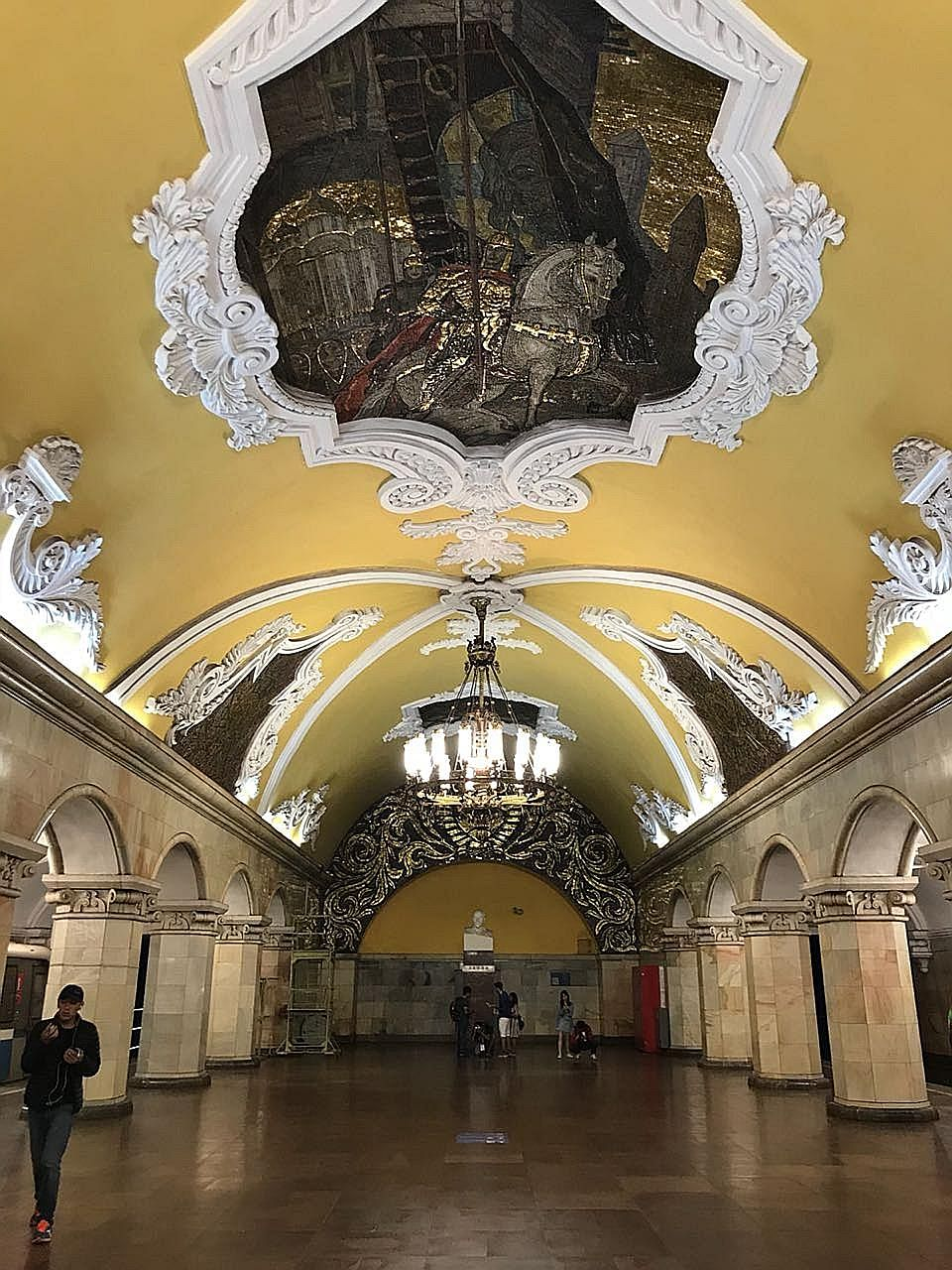 Mural at Park Pobedy, which features the world's fourth-deepest metro station at 84m underground. Komsomolskaya station has rich decoration devoted to the Soviet victory in the Great Patriotic War. A woman rubbing the nose of the dog b