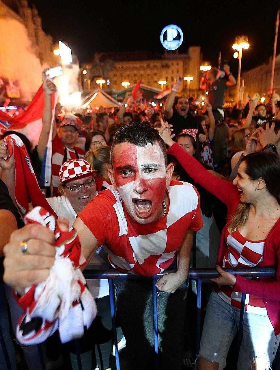 Croats painting the town red - and white - as they go wild in celebration after their country beat England 2-1 in extra time on Wednesday to qualify for the World Cup final for the first time.