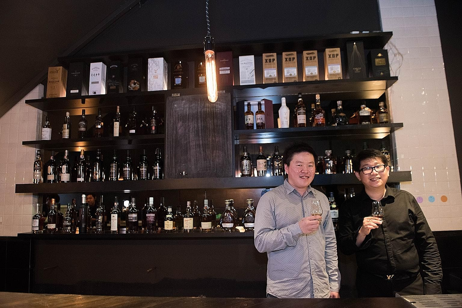 The Cooperage co-owners Paul Tan (left) and Ryan Wang want to make whisky as affordable as possible.