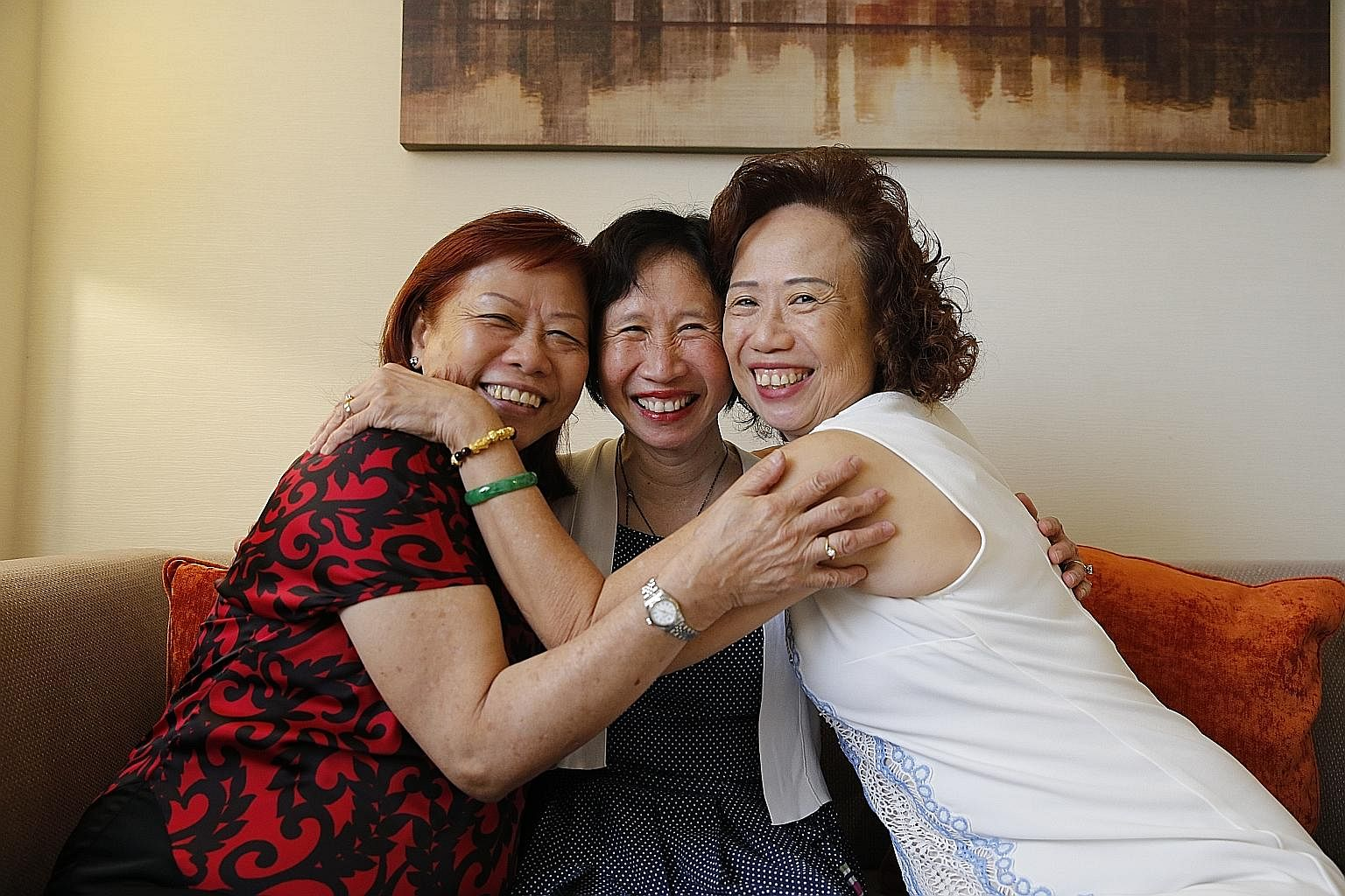 Mrs Eileen Kwong (centre) and her long-lost sisters, Madam Lily Wong (left) and Madam Jasmine Wong. Mrs Kwong said she never forgot her encounter in her teen years with a stranger on a bus who said she was her sister.