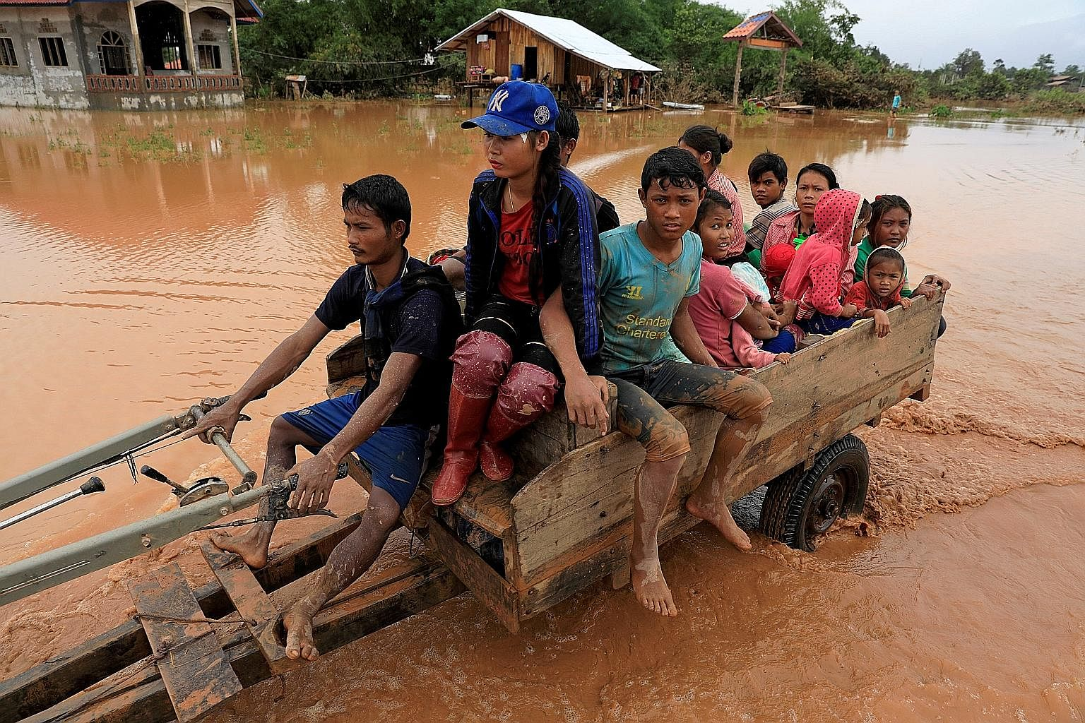 A family escaping the floods in Attapeu province, Laos.