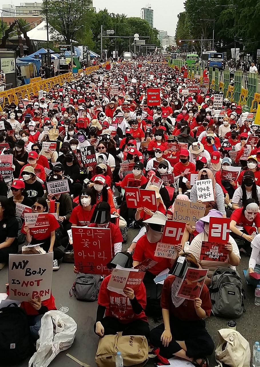 South Korean women staging a monthly protest in June against spy cam crimes. Among the offenders were teachers, church pastors, government officials, police officers and a court judge.