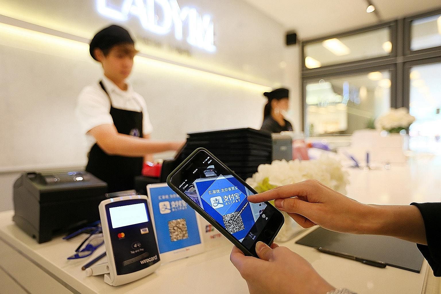Cake cafe Lady M, whose outlets at South Beach and Scotts Square are cashless, has seen shorter billing and waiting times for customers, among other benefits, after accepting only non-cash payment methods like Alipay.