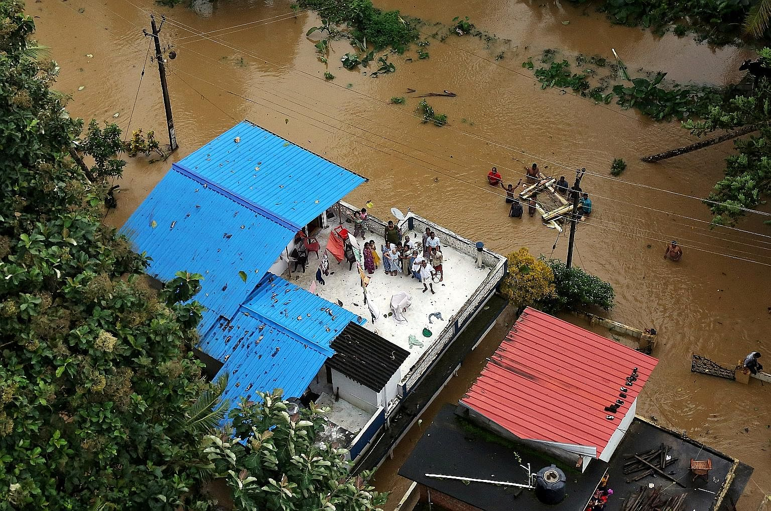 Thousands of people have been trapped by the worst floods to hit the southern Indian state of Kerala in a century. Some residents were spotted yesterday up on the roof waiting to be rescued. The death toll from the floods jumped to 324 yesterday, whi