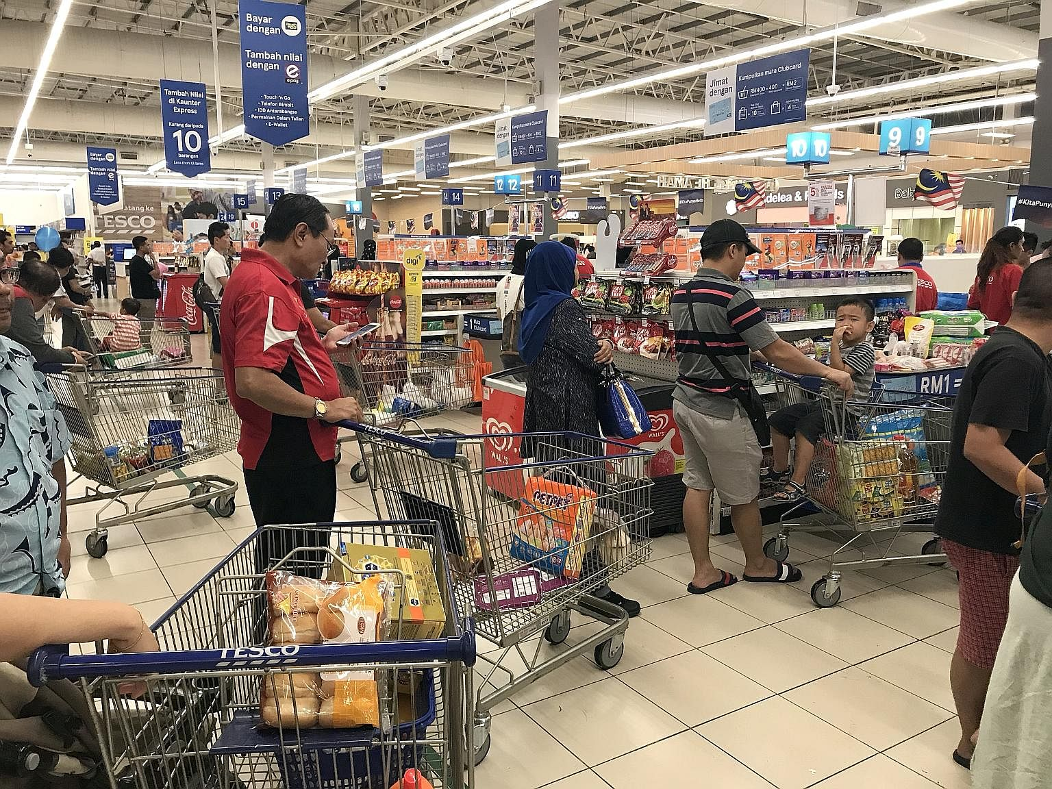 Long queues formed at Tesco Shah Alam in Selangor on Thursday as Malaysians did some last-minute shopping before the SST. Despite items such as eggs being exempt, some shoppers are stocking up anyway.