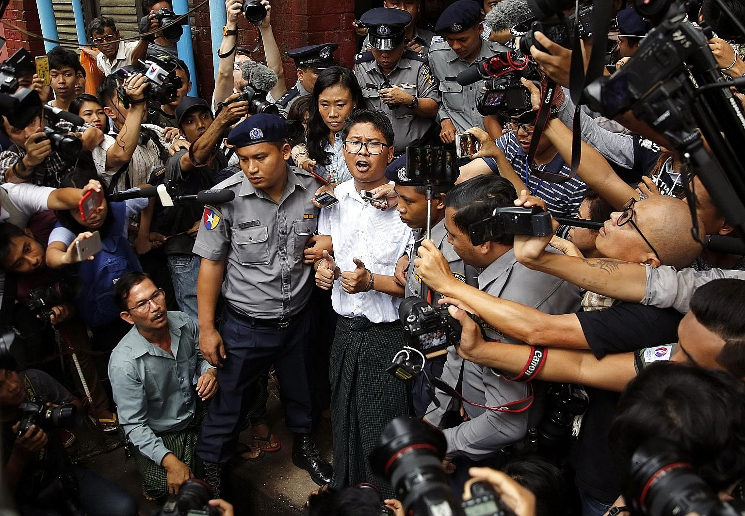 Reuters journalist Wa Lone (centre), 32, maintained his innocence outside a Yangon court yesterday after he was sentenced to seven years in jail with his colleague Kyaw Soe Oo, 28, for breaching a law on state secrets. They had said police planted do