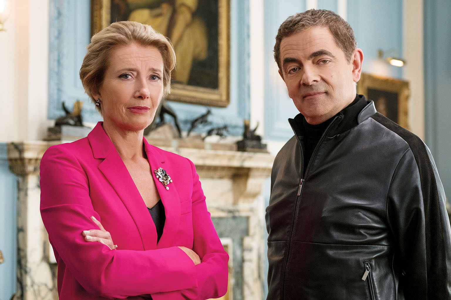 Emma Thompson (above, left) joins Rowan Atkinson, who plays the British secret service's last hope, in Johnny English Strikes Again (right).