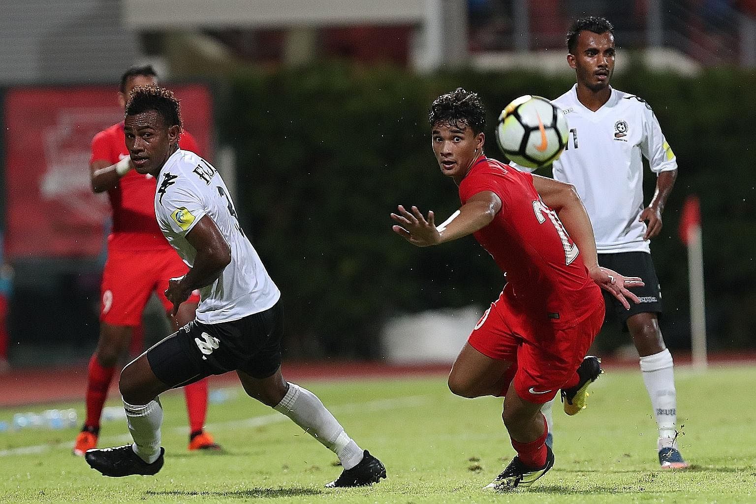 Two goals in two minutes, including the second from striker Ikhsan Fandi (at right), gave Singapore a 2-0 win over Fiji in a friendly at the Bishan Stadium last night. The result gave Ikhsan's father, Singapore icon Fandi Ahmad, his first win as inte