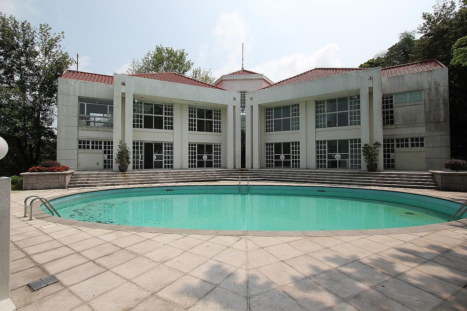 24 Middle Gap Road sits on 16,330 sq ft of land in Hong Kong's Peak neighbourhood and comes with a swimming pool, parking for two cars as well as some dated 1990s decor. While not considered palatial, it does offer an exclusive address and a rare opp